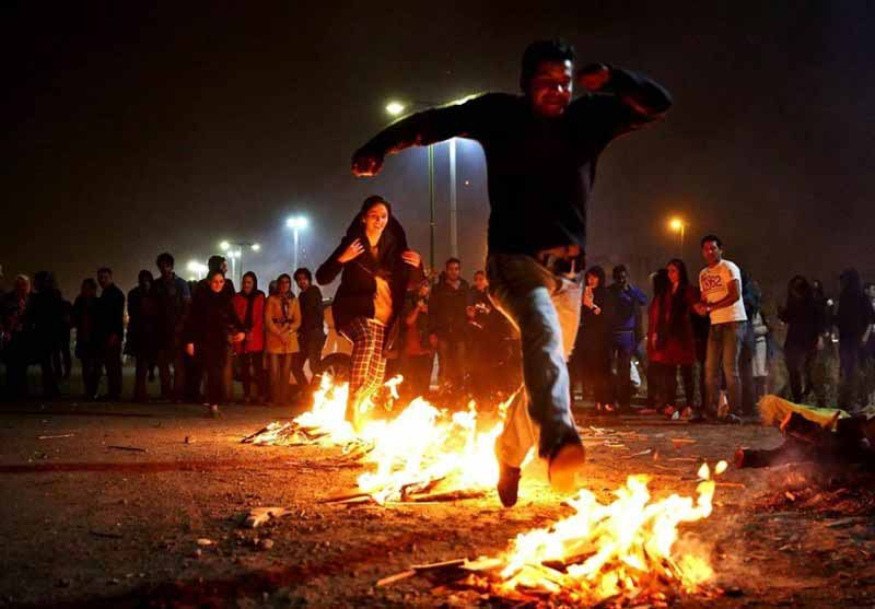 Chaharshanbe Suri ( Festival of Fire in Iran)-Iranians jump over fire, celebrating the last Wednesday of Persian Year