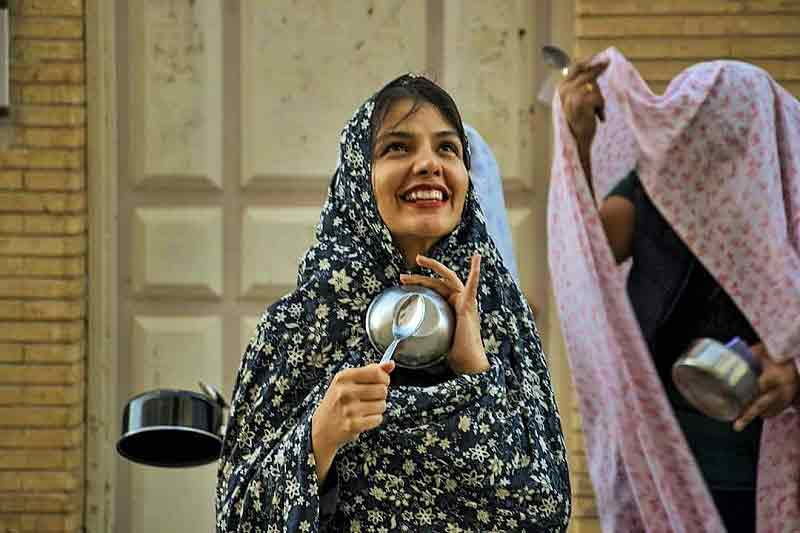 Trick or Treat in Iran known as Qashoq Zani-a girl banging a spoon on a bowl asking for treats
