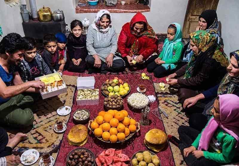 Yalda Night Spread-An Iranian family gathering around a spread to celebrate Yalda Night