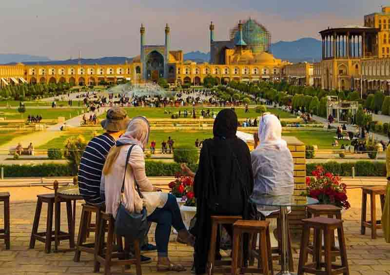 People enjoying the view of a square in Iran